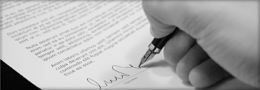 Close up of a male hand signing a document